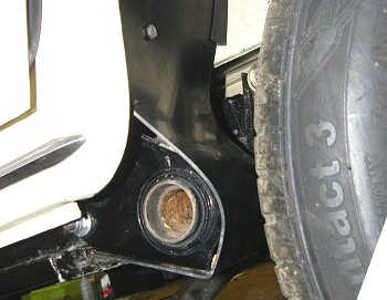 Front of rear wheelarch liner covering suspension mounting