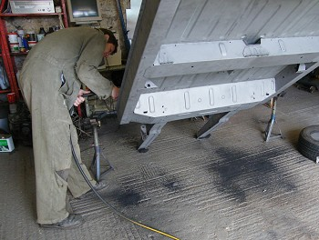 Renoving sand blasted into chassis sections